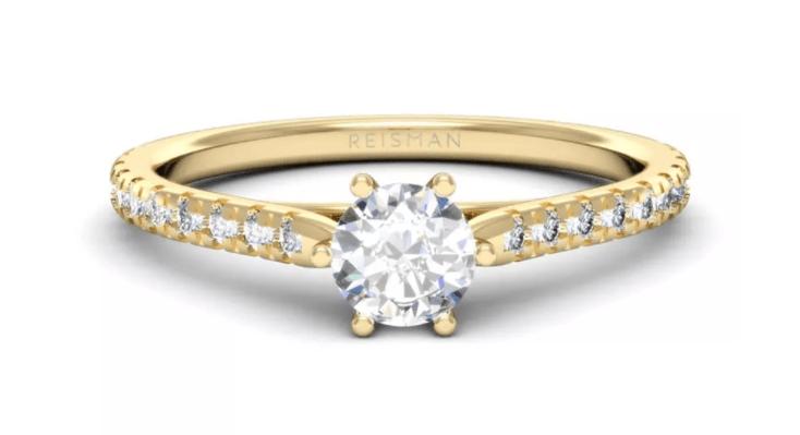 anel solitário com pedras laterais